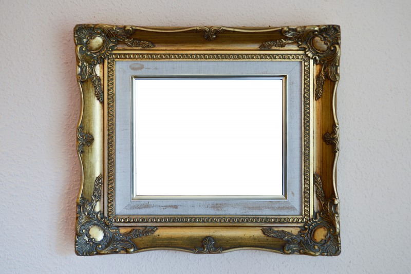 Blank painting frame on wall