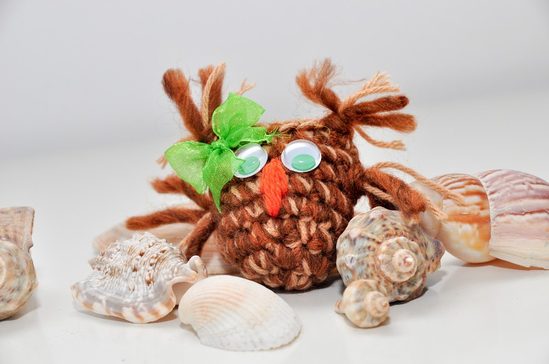 Funny wool mascot and sea shells