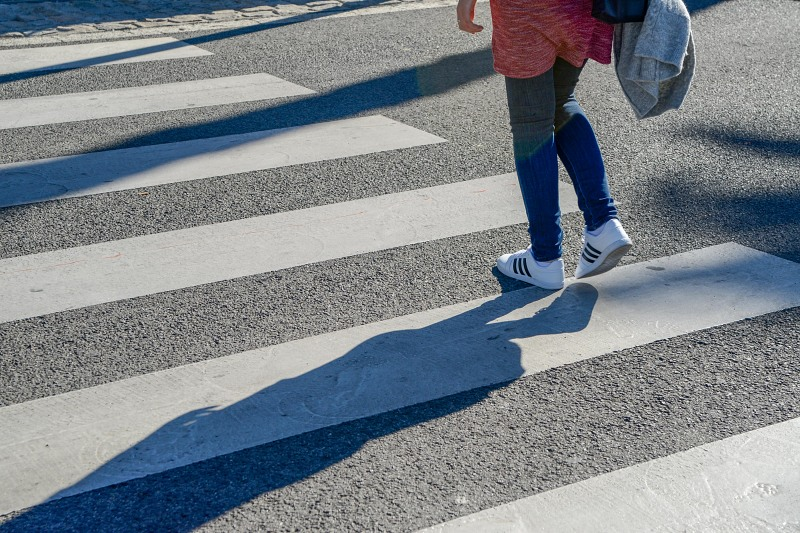 Girl jeans pedestrian crossing