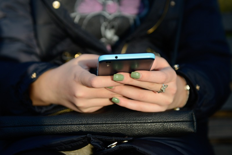 Texting messages on smartphone