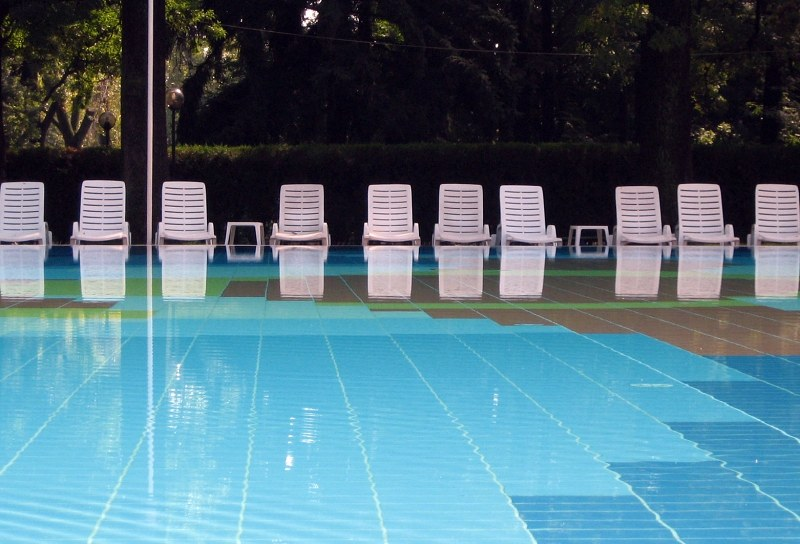 Beach chairs beside pool