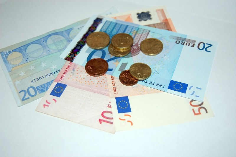 Multiple coins and euro banknotes