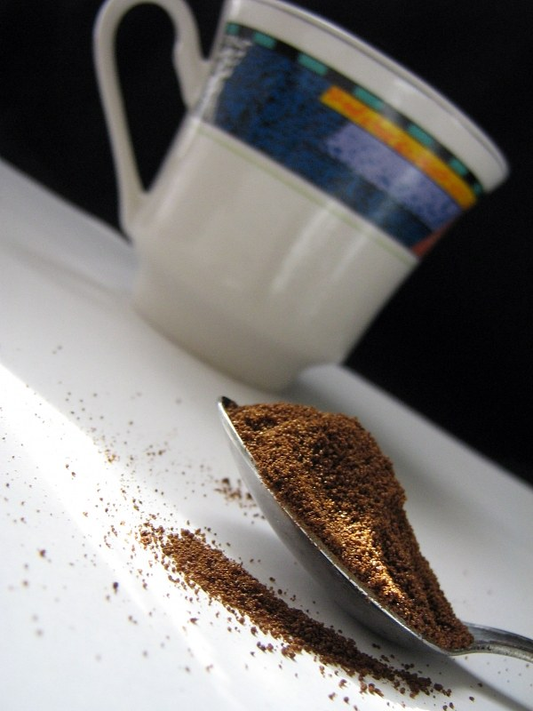 Spoon of grinded coffee