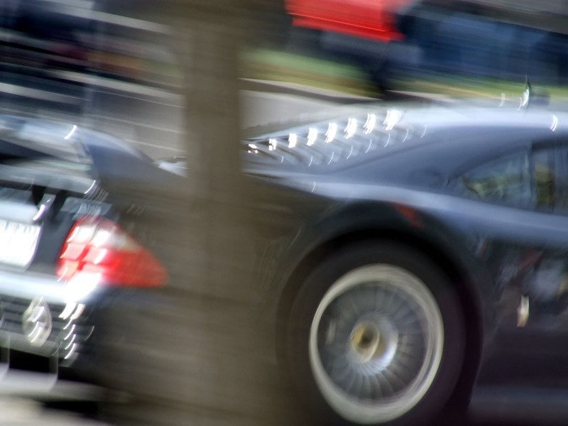 Sports car back passing in speed