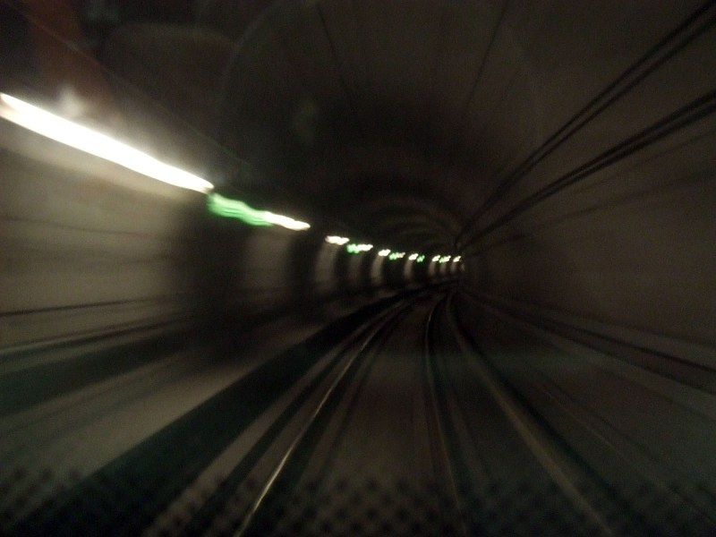Train running trough tunnel