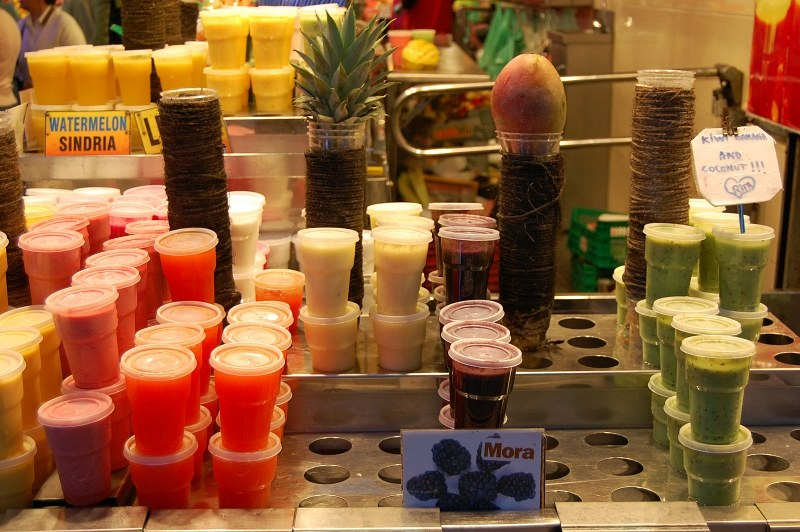 Tropical fruit juice recipients made of plastic in different colors