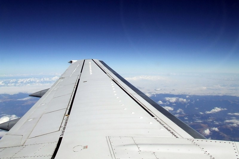View over airplane wing from seat