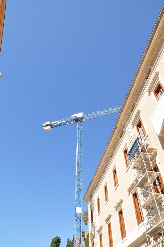 Crane next to a building in construction
