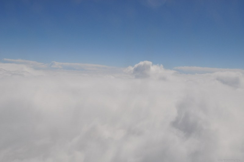 In flight over clouds