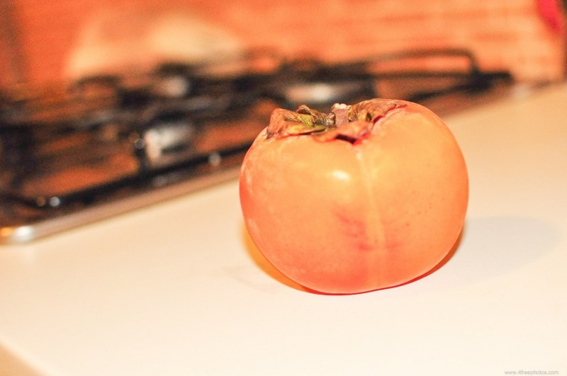 Persimmon fruit on kitchen table