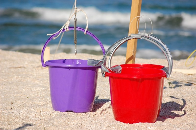 Plastic buckets in sand
