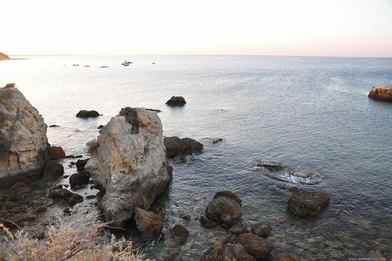 Rocks and ocean at sunset