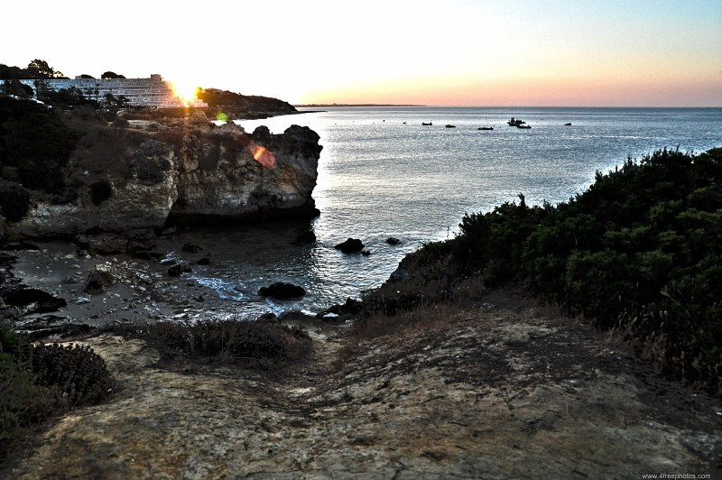 Sunrise over Algarve rocky shore