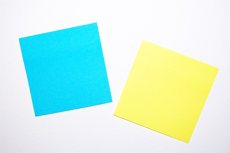 White and blue post-it notes on wall