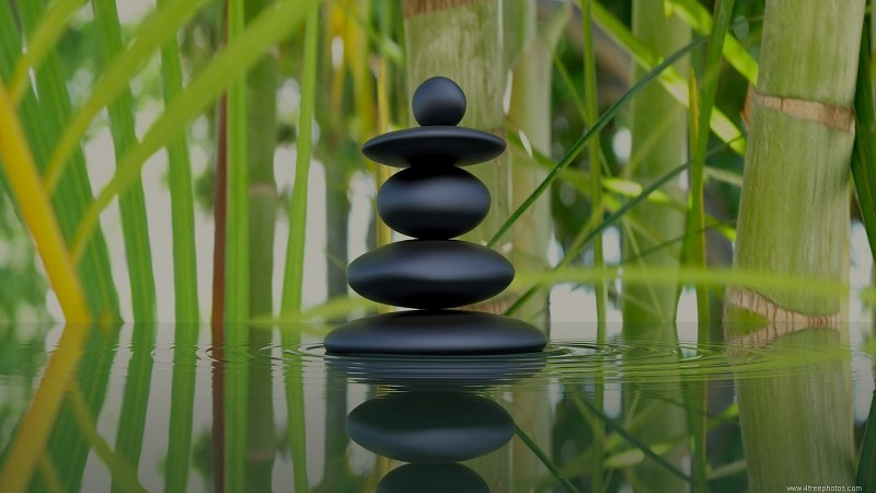 Zen stones and bamboo reflection