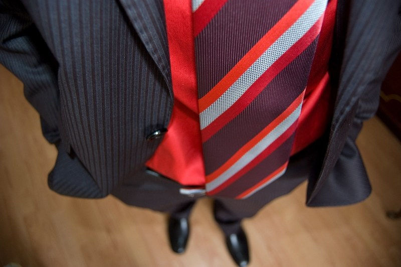 Suit and red tie