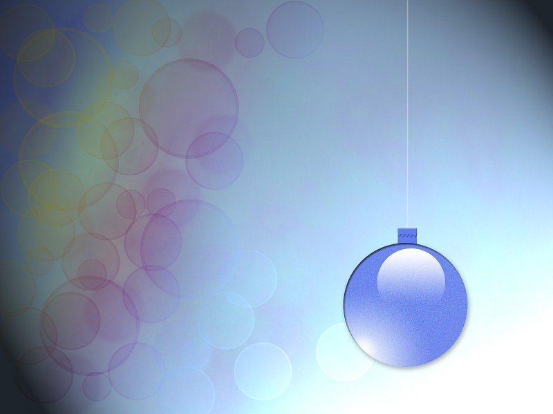 Christmas bauble on blurred lights background