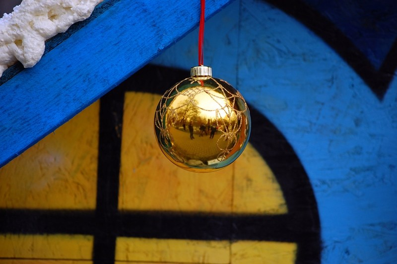 Christmas bauble over colored background