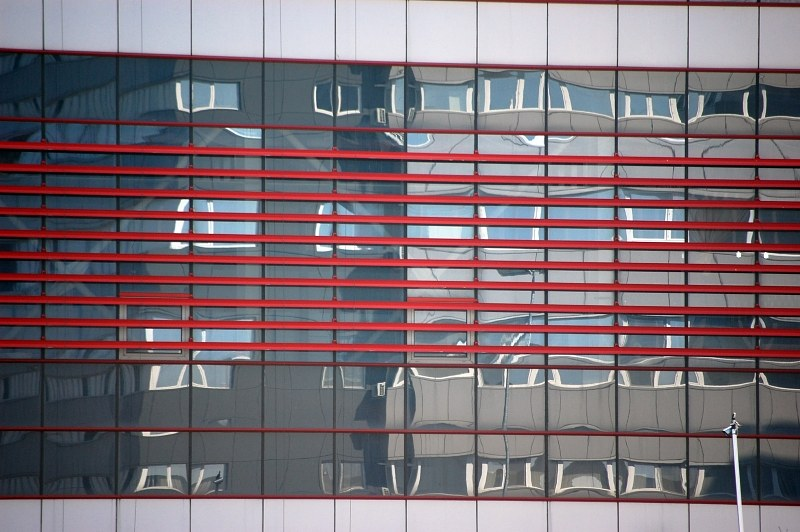 Glass building facade reflection