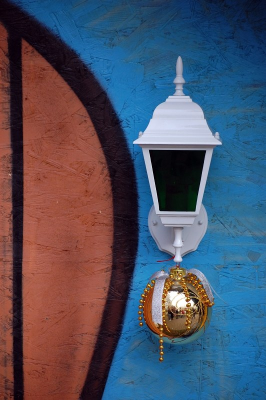 Lamp on colored house