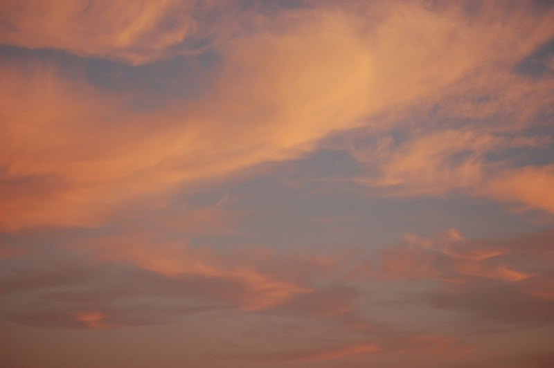 Orange sky at dusk with thin cloud layer