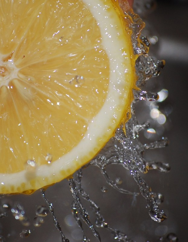 Splashing water from a lemon
