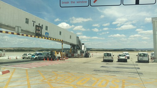 Airport vehicles parked near gate