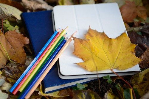 Autumn student crayons and notebooks