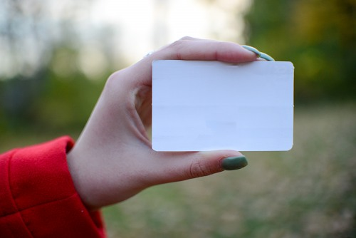 Blank card in woman hand