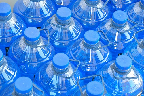 Blue plastic water bottles