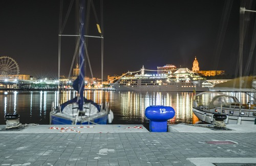Boats and cruise ship in Malaga port at night