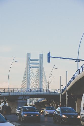 City traffic evening bridge