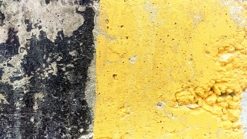 Concrete block yellow painted