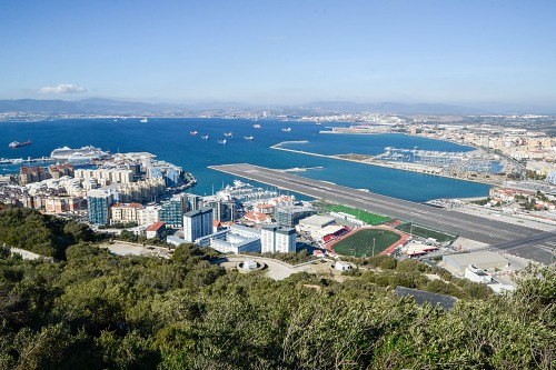 Gibraltar airport runway and city