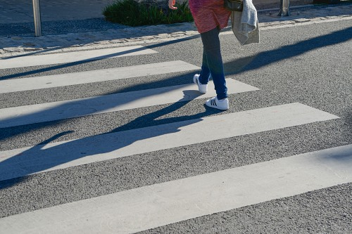 Girl in jeans outfit crossing street