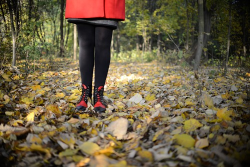 Girl in red coat in forest