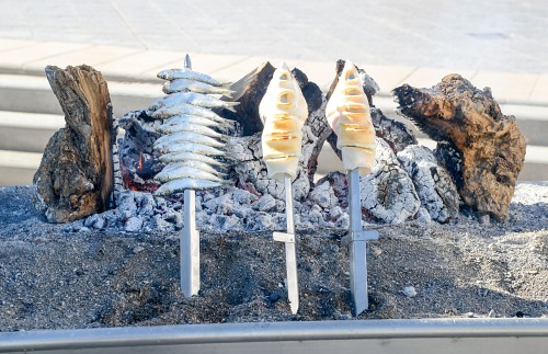 Grilled sardines on stick