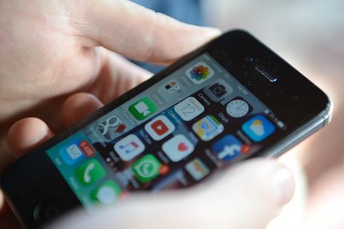 Man loooking at an modern iphone