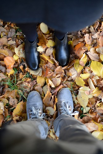 Man woman hug feet leaves autumn park
