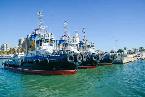 Row of tug boats in port