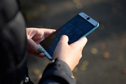 Smartphone in young woman hands