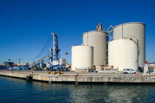 Storage tanks and crane industrial port