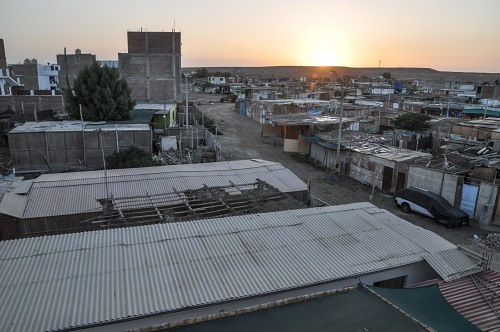 Sunrise over desert shanty town