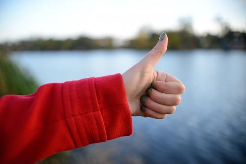 Thumbs up woman hand