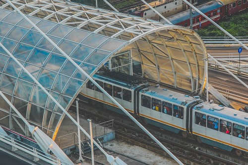 Tram in modern glass roof station