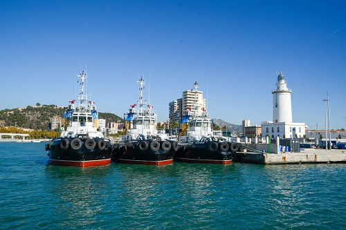 Tug boats and lighthouse