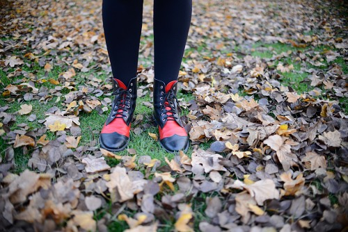 Woman boots autumn leaves