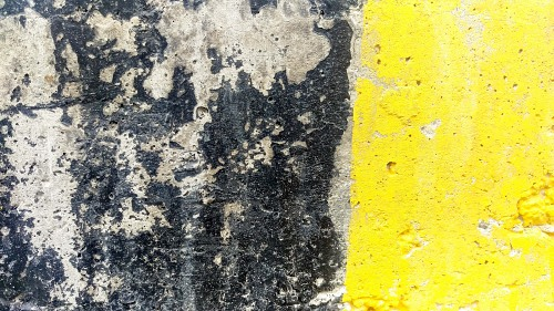Yellow adn black painted concrete block