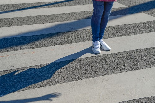 Young woman pedestrian crossing
