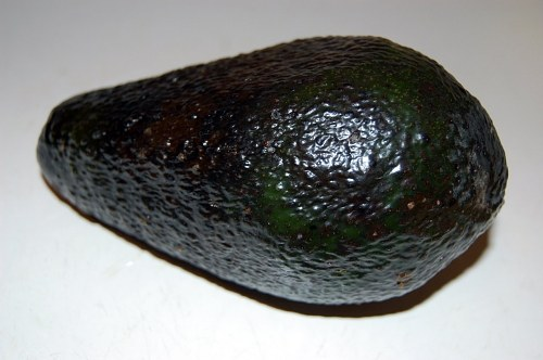 Avocado fruit on table
